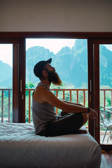 Man relaxing on bed at home