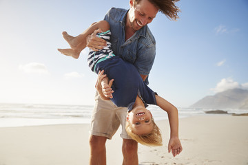 Father Having Fun With Son On Summer Beach Vacation Wall mural