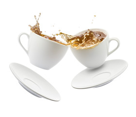 Fototapete - two cup of tea jumps and clash with splashing on white background