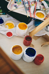 Aerial view of acrylic colors and painting material.