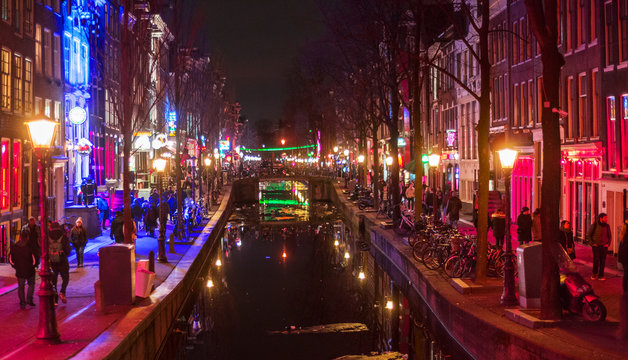 Amsterdam red district prostitution quarter street, canal at night