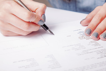 Female model signing and completing personal information on a form of Model release.