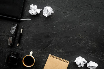 retro and modern writer desktop with coffee, notebook and ink on black table background top view mock up