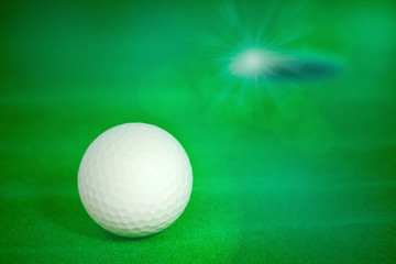Golf ball / View of old golf ball on green artificial grass background.