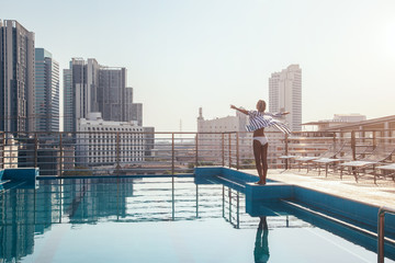 Woman standing in roof pool