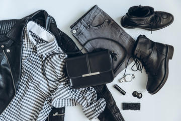woman clothes flat lay. overhead view. black white concept