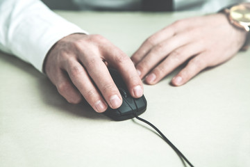 Businessman hand with computer mouse.