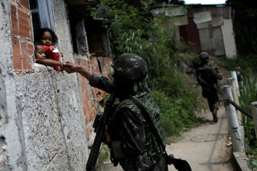 Brazilian Armed Forces patrol during an operation against drug gangs in Rio de Janeiro