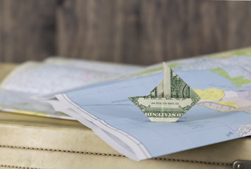 Paper Money Sailboat on a Map