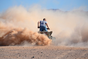 Four Wheeler Dust Cloud