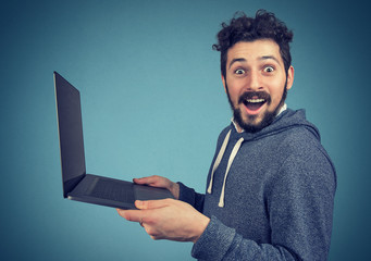 Surprised man with laptop computer