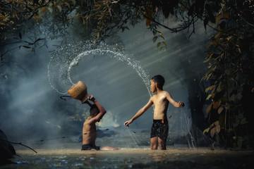 Children with waterfall