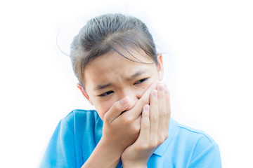 Asian girl felling toothache on white background,Tooth decay and oral health in children.
