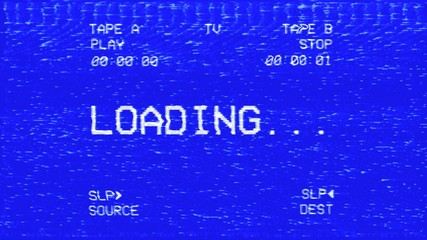 An old damaged VHS tape tracking a bad signal coming from a double deck, with the text Loading.