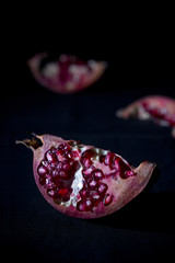 Pomegranate over black background