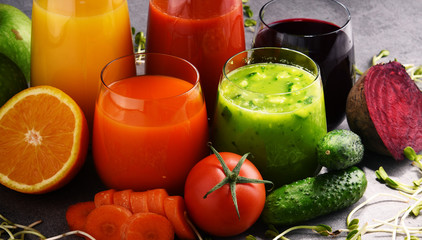 Glasses with fresh organic vegetable and fruit juices