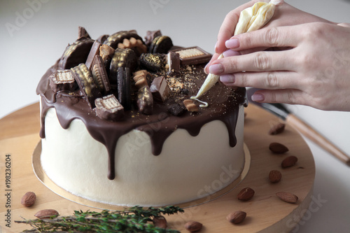 The Confectioner Makes An Inscription Of Congratulations On A