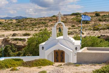 Traditional Greek whitewashed church in Agios Konstantinos on the island of Milos. Cyclades, Greece.