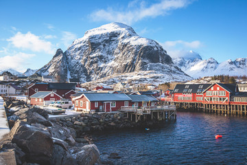 Garden Poster Scandinavia Beautiful super wide-angle winter snowy view of fishing village A, Norway, Lofoten Islands, with skyline, mountains, famous fishing village with red fishing cabins, Moskenesoya, Nordland