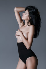 pretty dark hair model close her eyes and waiting in black lingerie