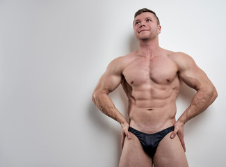 Athlete posing with naked torso