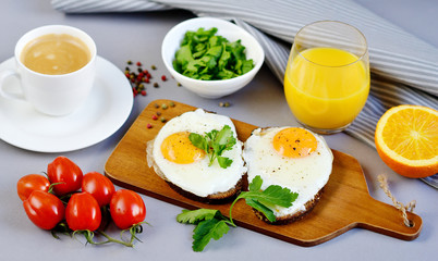 Morning Coffee White Cup Beverage Orange Juice Sandwich with Tasty Fried Egg Served on a Wooden Tray Parsley Pepper Tomato Cherry Grey Background Healthy Food Concept Vegetarian Modern Lifestyle