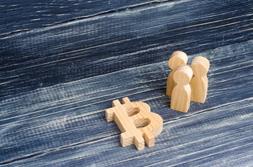 Wooden figures of people are standing near a bitcoin on a black background. Crypto currency, blockchain technology. The collapse and rise cost of bitcoin. Mining farms, miners, stock exchange crypts.