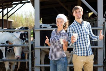 Man and woman having glass of fresh milk