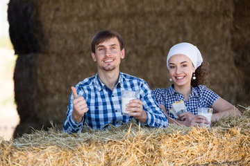 man and woman in hay with milk