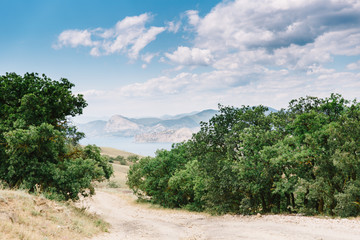 Crimean landscape. View from the road to the mountains on the horizon. Meganom cape, Russia, peninsula of Crimea.