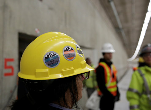 Stickers are pictured on hard hat during SR 99 highway tunnel media tour in Seattle