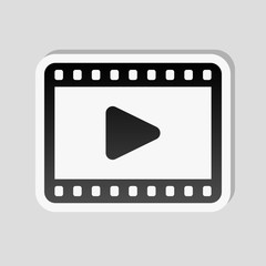 video icon. Sticker style with white border and simple shadow on gray background