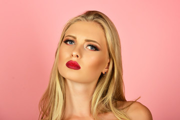 Sensual blond girl. Skincare, haircare, beauty concept - beautiful fashion model woman face with perfect skin, red lips. Sexy blonde woman with luxury makeup. Copy space for advertise beauty/spa salon