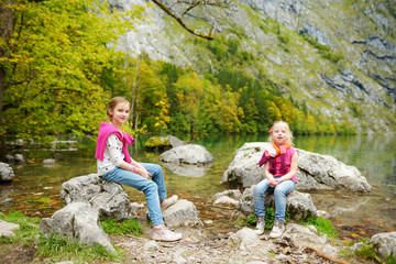 Fototapete - Little girls enjoying the view of deep green waters of Obersee, located near Konigssee, known as Germany's deepest and cleanest lake, Germany