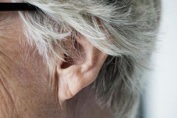 Closeup of elderly woman ear