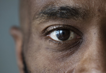 Closeup of an eye of a black man Fototapete
