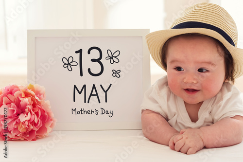 bf59d350cc Mother s Day massage with happy baby boy with a pink flower