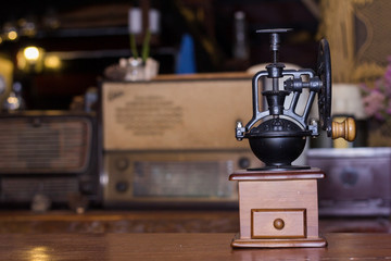 Coffee grinder is placed on the table.