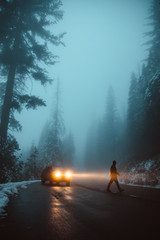 Man crossing road during foggy weather