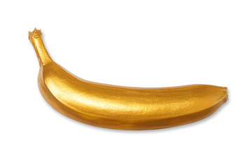 Golden banana isolated on a white background. Creative concept with fruit. View from above, flat lay