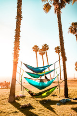 Friends in Hammocks and Palm trees
