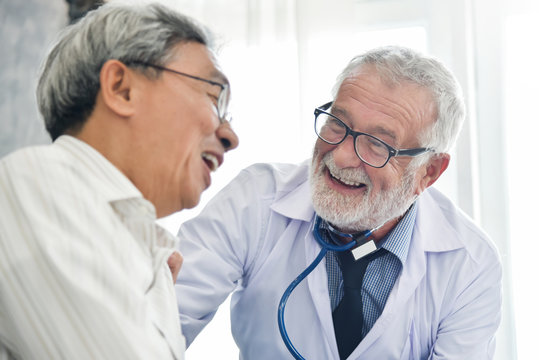 Happiness of Senior male Doctor with Asian male patient.