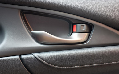 Detail of interior Car door handle.