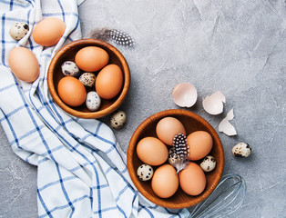 Eggs and wooden bowls