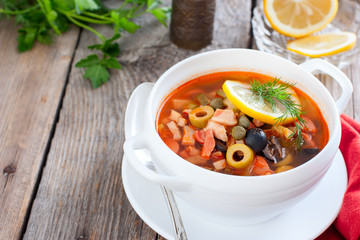 Traditional Russian soup Solyanka in Moscow, horizontal, copy space