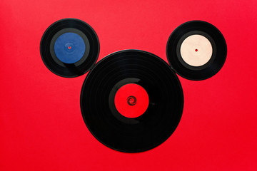 Top view of old vinyl records as Mickey Mouse theme.