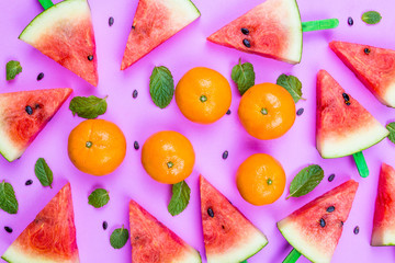summer concept watermelon slice popsicles on a pink  background