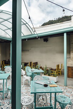 Side view of a cozy terrace in a coffee shop in Bogota, Colombia