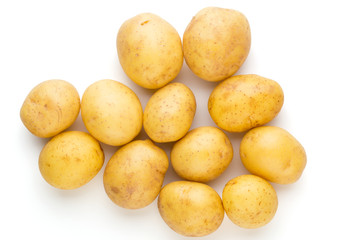 New potato and rosemarin isolated on white background close up.