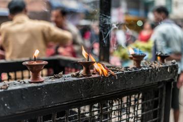 Lighted lamps on metal grille in Kathmandu, Nepal
